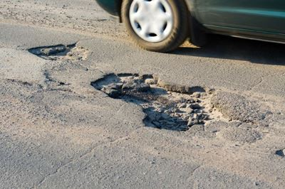 Repairing Potholes in Roads Resulting from a Harsh Winter